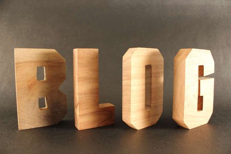 buchstaben: Blog text from wood letters Holz Buchstaben black Background