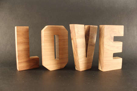 Love text from wood letters Holz Buchstaben black Background