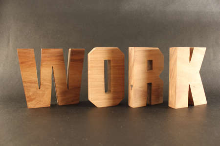 naturholz: Work text from wood letters Holz Buchstaben black Background Stock Photo