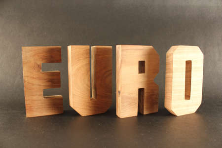 naturholz: Euro text from wood letters Holz Buchstaben black Background