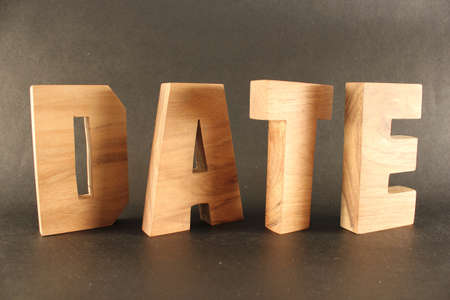 buchstabe: Date text from wood letters Holz Buchstaben black Background