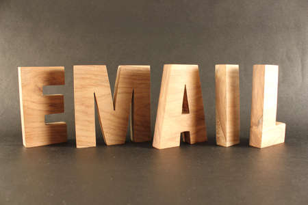 lettre: Email text from wood letters Holz Buchstaben black Background