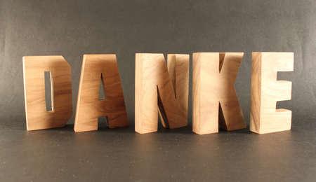 buchstabe: Danke text from wood letters Holz Buchstaben black Background