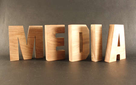 naturholz: Media text from wood letters Holz Buchstaben black Background
