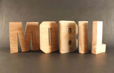 naturholz: Mobil text from wood letters Holz Buchstaben black Background