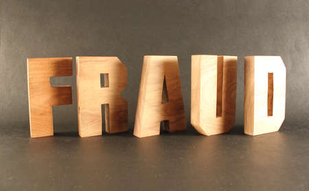 naturholz: Fraud text from wood letters Holz Buchstaben black Background