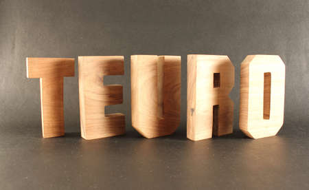 Teuro text from wood letters Holz Buchstaben black Background