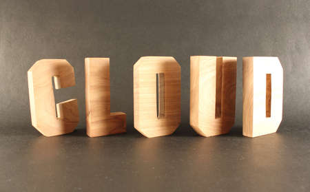Cloud text from wood letters Holz Buchstaben black Background