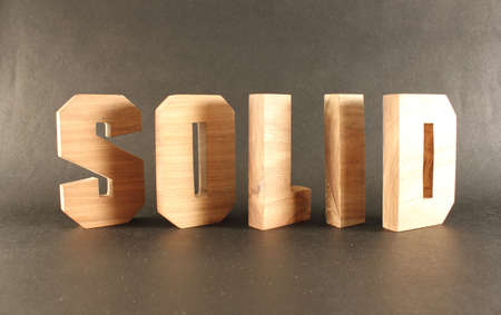 lettre: Solid text from wood letters Buchstaben black Background