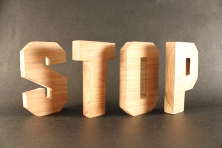 Stop text from wood letters Buchstaben black Background