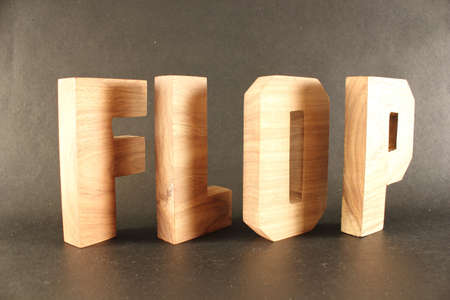buchstaben: Flop text from wood letters Buchstaben black Background