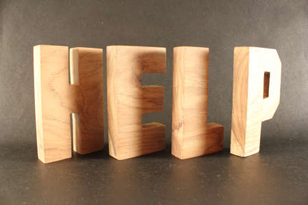 naturholz: HELP text from wood letters Buchstaben black Background Stock Photo