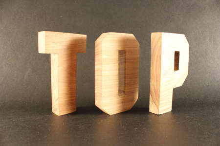 buchstabe: TOP text from wood letters Holz Buchstaben black Background