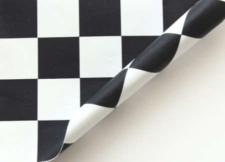 Checkered flag rolled up black and white