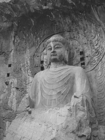 wei: This is the great seated Buddha at Longmen Caves outside of Louyang China. Stock Photo