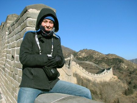 great: Woman sitting on the Great Wall of China at Badaling, outside of Beijing.