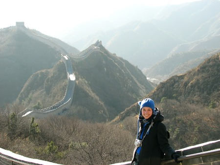 stone wall: A Female tourist with the Great Wall of China at Badaling in the background.  Stock Photo