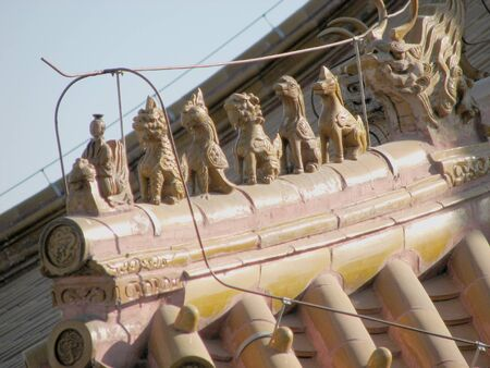 This image depicts the set of mythical power animals displayed on the roof tops of the forbidden city in Beijing China.