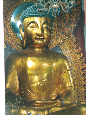 chan: This is a seated Buddha statue at the Temple of The Six Banyan Trees, in Guangzhou, China.
