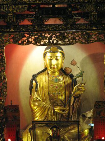 compassionate: a Taiwanese stle bodhisattva statue representing the compassionate aspect of the Buddha. Stock Photo