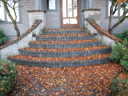 door way: a door way covered with fall leaves Stock Photo