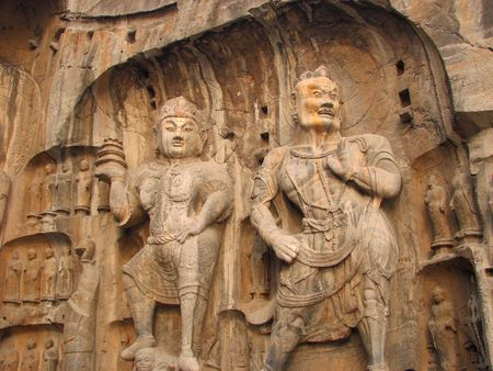 wei: A giant stone representaion of a Bodhisattva and Guadian of The Buddha. Rock cut at Longmen Caves China. Stock Photo