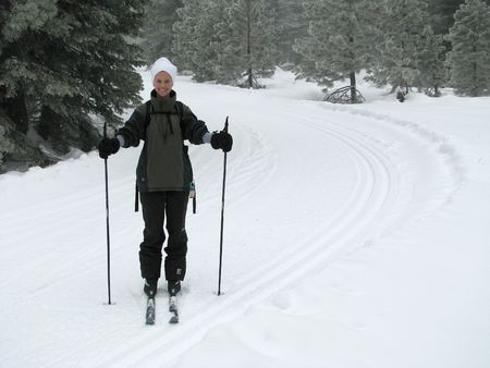 snow break: A beautiful young woman cross country skiing in the California Mountains.  Taken on Mt. Shasta, California.