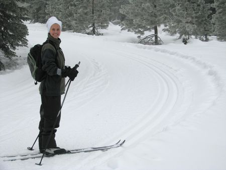 A beautiful young woman cross country skiing in the California Mountains.  Taken on Mt. Shasta, California. photo