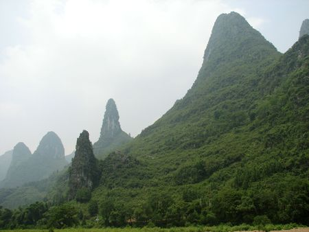 A group of large rock outcroppings on the banks of the Li river in Guilin, China.