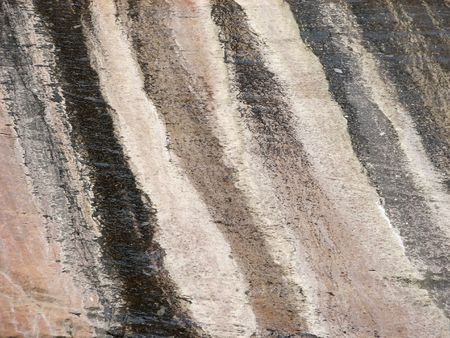 Layers of sand compressed in to smooth stone on a cliff face in Zion National Park.  Utah, U.S.A.