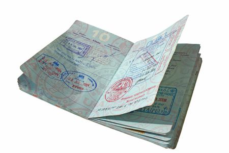 An open United States passport in isolation with pages covered in stamps from Asian and southeast Asian Countries. Stock Photo