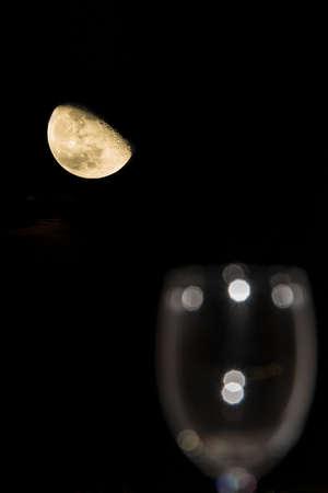 half moon: Half moon and an empty wine glass