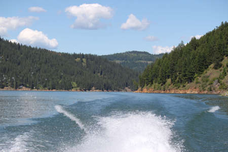 Spray from a inboard motor on Dworshak lake in Idaho. Stock Photo