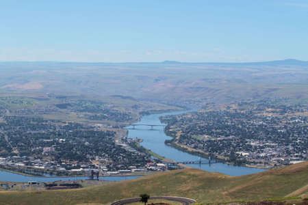 The river going from left to right is The Clearwater river. The River with the two bridges is the Snake river. Lewiston Idaho is on the left side of the Snake river and Clarkston Washington is on the right.