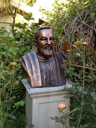 pio: St. Pio petrilcina bust located in libis. Manila. Philippines Stock Photo