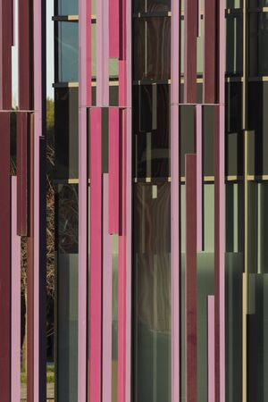 Zaragoza, Spain - February 2, 2020: Abstract vertical lines in the facades of the former grounds of the Vidal de Canellas building. Stock Photo