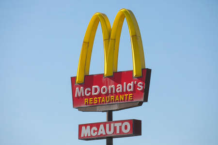 Madrid, Spain - March 11, 2020: McDonald's McAuto sign in Madrid, in district Ciudad de la Imagen. McDonald's is the world`s biggest fast food franchise serving millions of meals all over the world.
