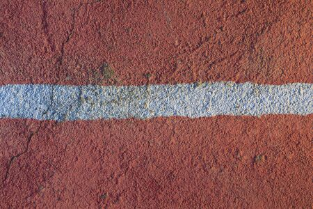 Floor of a concrete outdoor sports court, painted in an intense, vivid and saturated color, represents the concept of change, limit or transformation. This photo was taken in Indonesia.