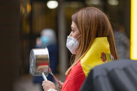 Madrid, Spain - May 16, 2020: People demonstrate against the government with pans, making noise, in the Retiro district, during the state of alarm and the lockdown de-escalation.
