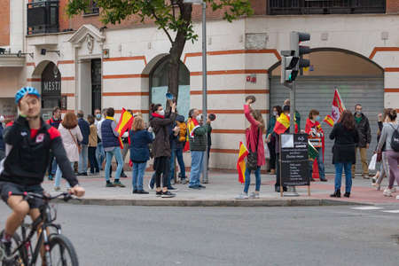 Madrid, Spain - May 16, 2020: A group of people demonstrate against the government with pans, making noise, in the Retiro district, during the state of alarm and the lockdown de-escalation.