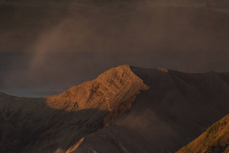 Landscapes and sunrise details at the active volcano Bromo, and the Tengger massif, in East Java, Indonesia.
