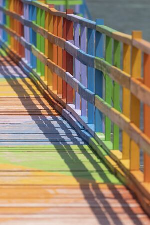 Wooden promenade decorated with vibrant and diverse colors, facing the sea and among the mangroves, in the city of Wakai, in the Togean Islands, Indonesia. Reklamní fotografie