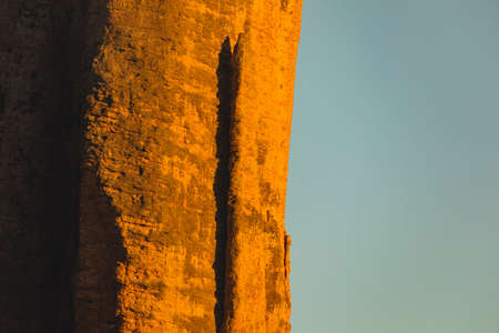 Mountains of the Mallos de Riglos, vertical rock walls at sunset, a famous place for climbing near the Gallego river, in the pre-Pyrenees, Huesca province, Aragon, Spain. Imagens