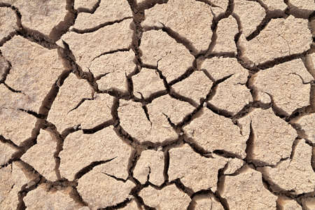 Dry and cracked land, dry due to lack of rain, in the Loteta reservoir, near the town of Gallur, Spain. Effects of climate change such as desertification and droughts. Stock Photo
