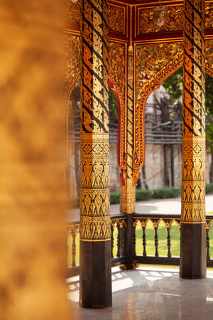 Bangkok, Thailand - March 25, 2018: Small temple or chapel, with plant motifs drawn on its columns next to Phra tamnak Daeng, in Bangkok National Museum, example of Thai architecture.