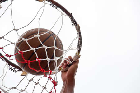 Basketball in the net Stock Photo