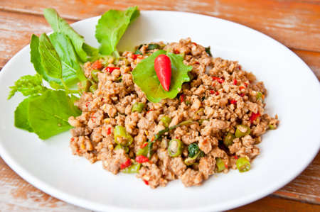 long bean: Delicious Thai food call PUD KAPRAO MOO made from fried pork with spicy ingredient chili ,garlic,long bean,fish sauce, basil eat with rice