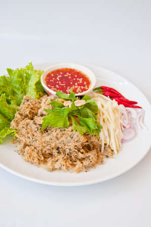 Delicious Thai food call YUM PLADUK FU from fried catfish and spicy ingredients and onion and raw mango photo