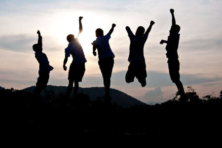 teamwork together: Silhouette of  happy children Stock Photo