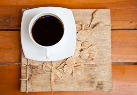 blank paper and black coffee on wood background photo